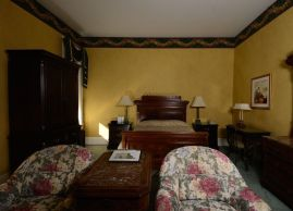 Antiques bring warmth and charm to this suite, The Waterloo Hotel