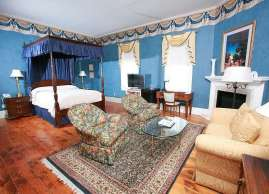 The canopied four poster rice bed is the focus of this room