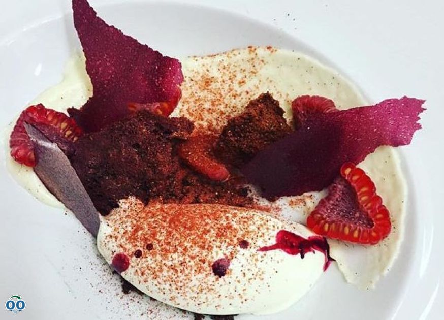 Creamy goat cheese, raspberries and beets served, Ferreira Café
